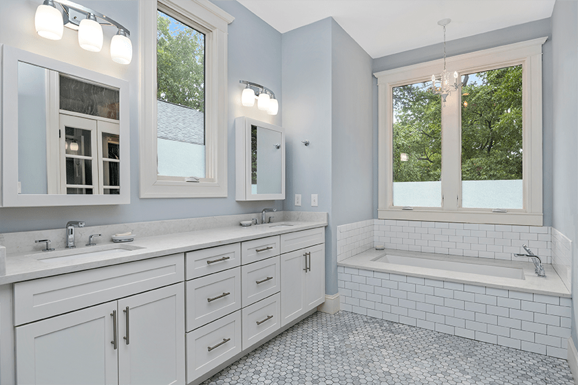 white bathroom remodel with tile and large windows